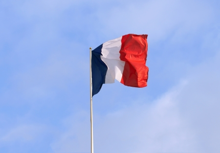 Flag of France over a blue sky photo