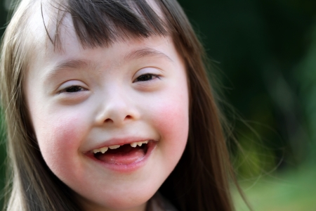 disable: Portrait of beautiful young girl smiling in the park