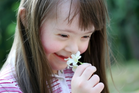 disabled: Portrait of beautiful young girl with flowers in the park