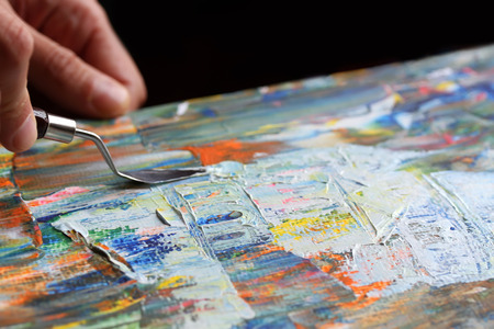 Kunst schilderen met paletmes