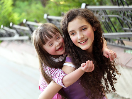 disabled: Happy girls in the park. Stock Photo