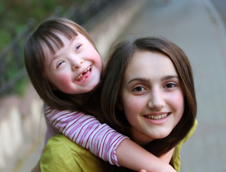 down's syndrome: Happy family moments - Mother and child have a fun
