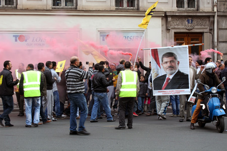 liberties: Egyptian Pro-Morsi protesters take part in a demonstration on Apr.25, 2014 in Paris, France. Mohamed Morsi served as the fifth president of Egypt, from June 2012 to July 2013 Editorial