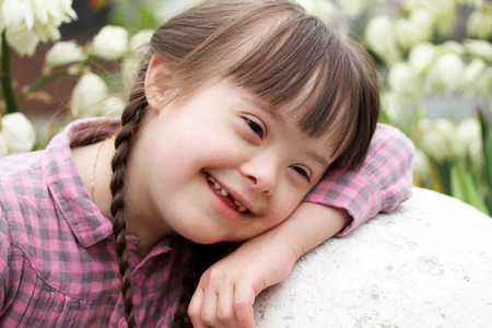 Portrait of beautiful young girl smiling photo