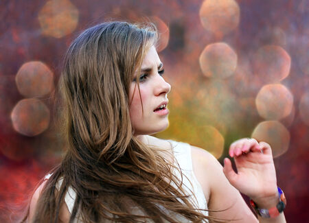 fashion photography: Happy girl on background of the bokeh Stock Photo