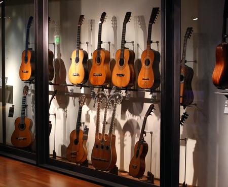 musique: Collection of old guitars  in MUSEUM CITÉ  DE LA  MUSIQUE  on jul.02, 2014 in Paris, France.