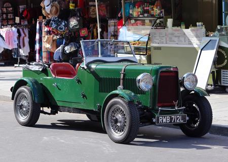 transporter: Green rarity english vintage car on Paris street