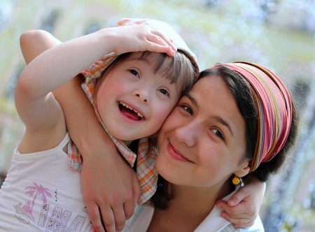 people with disabilities: Happy family moments - Mother and child have a fun