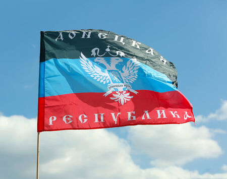 donbass: Donetsk Republic  Flag on background the sky