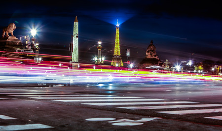 la tour eiffel: View on motion blur on background of the Luxor Obelisk and Eiffel Tower in the night on the Place de La Concorde in Paris, France.