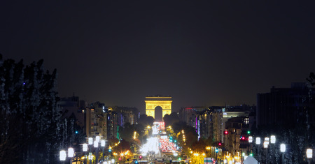 champs elysees quarter: Champs-Elysees Avenue with the Arc de Triomphe in Paris France at night. Editorial