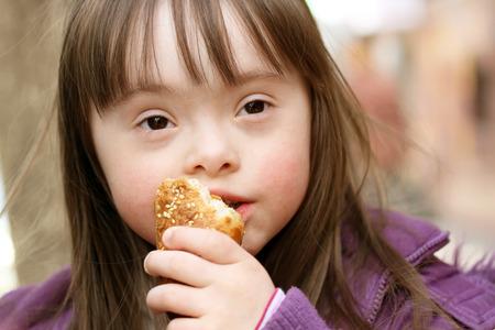 eating: Portrait of beautiful girl that eating baguette
