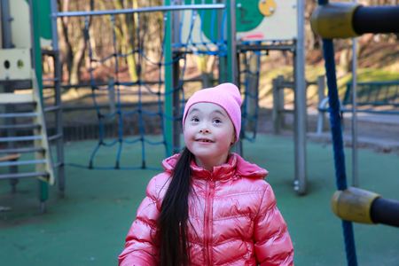 playgroup: Portrait of beautiful girl on the playground