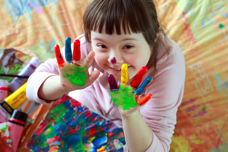 children at play: Cute little girl with painted hands
