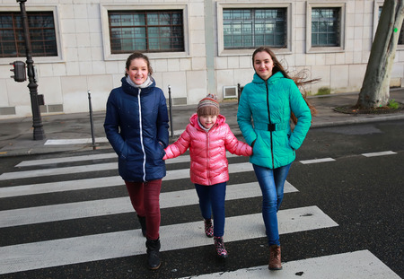 urban parenting: Happy family moments - girls having fun in the city