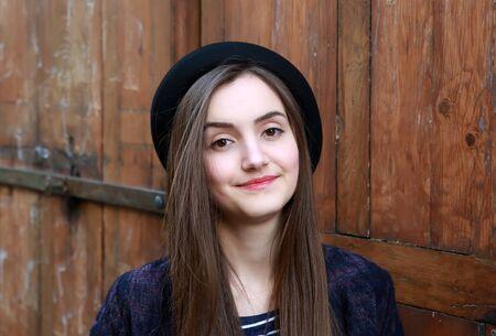 modern girls: Close-up portrait of beautiful girl on vintage background