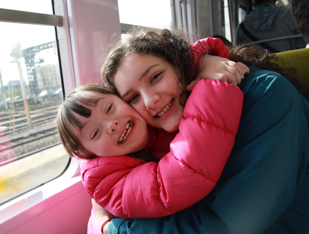 urban parenting: Portrait of girls in the train Stock Photo