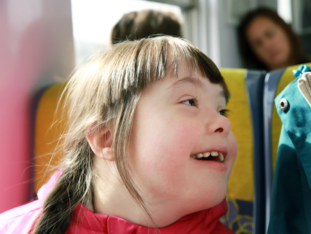 urban parenting: Portrait of girl in the train