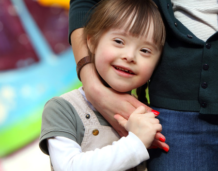 people with disabilities: Happy family moments - Mother and child have a fun. Stock Photo