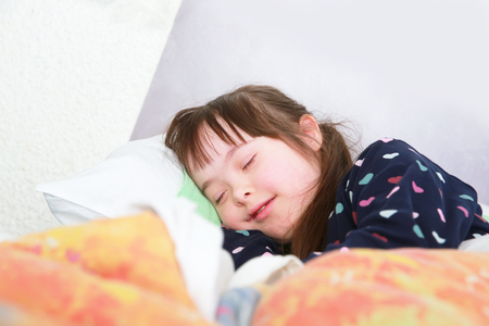 downs syndrome: Little girl sleeping at home