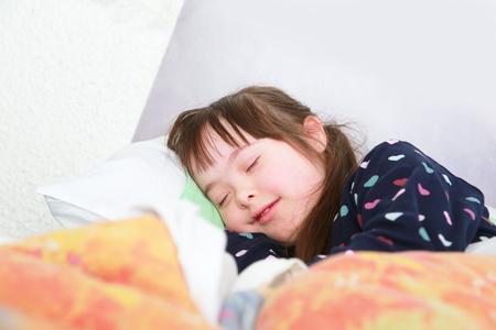 Little girl sleeping at home