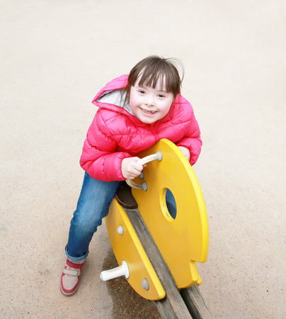 totter: Little girl on the playground