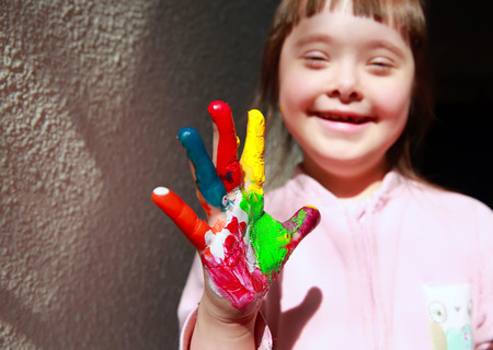 Cute little girl with painted hand