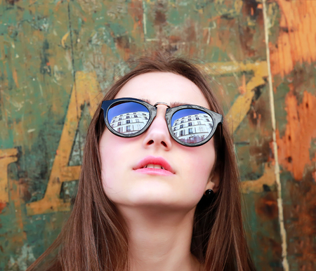 woman  glasses: Close-up portrait of beautiful girl on vintage background