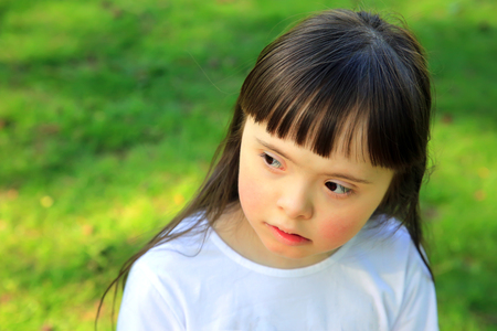 one family: Portrait of beautiful young girl in the park Stock Photo