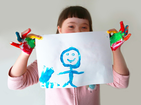 children hands: Cute girl with her painting