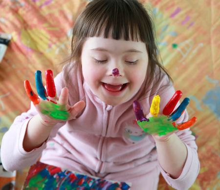colorful paint: Cute little girl with painted hands