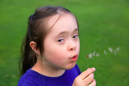 blowing dandelion: Little girl blowing dandelion Stock Photo
