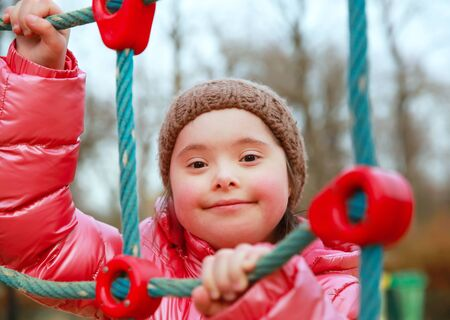 young: Portrait of beautiful girl on the playground