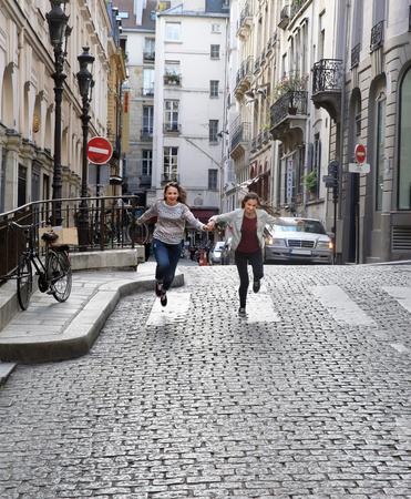 Happy beautiful student girls in Paris