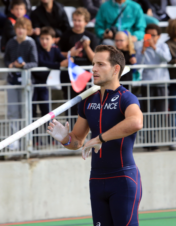 world record: PARIS, FRANCE - SEP.13: Lavillenie Renaud on DecaNation International Outdoor Games on September 13, 2015 in Paris, France. He is Olympic champion and World record holder jump pole vault with 6m16