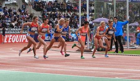 gloria: Athletes compete in the 1500 meters race on DecaNation International Outdoor Games on September 13, 2015 in Paris, France. Editorial