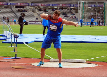 konstantin: Konstantin Lyadusov from Russia COMPETES in the mens Shot Put on DecaNation International Outdoor Games on September 13, 2015 in Paris, France. Editorial