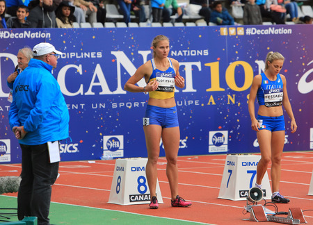 hurdles: Anna Plotitsyna and Giulia Tessaro on the start of 100 meters hurdles race on DecaNation International Outdoor Games on September 13, 2015 in Paris, France.