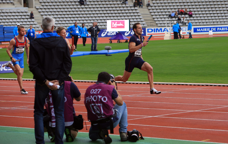 world record: Renaud Lavillenie running relay race on DecaNation International Outdoor Games on September 13, 2015 in Paris, France. He is Olympic champion and World record holder Editorial