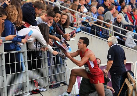 steeplechase: American athlete Donn Cobral signing autographs after 3000 meters steeplechase race on DecaNation International Outdoor Games on September 13, 2015 in Paris, France.