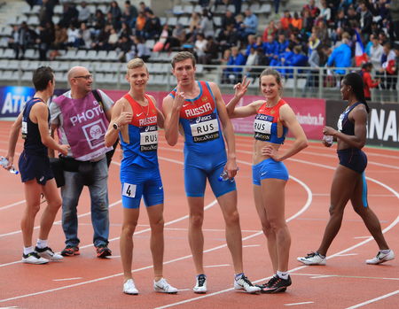 the place is outdoor: Russian Track and Field team celebrate first place in relay race on DecaNation International Outdoor Games on September 13, 2015 in Paris, France.