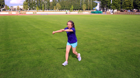 sports field: Little girl have fun on the stadium Stock Photo