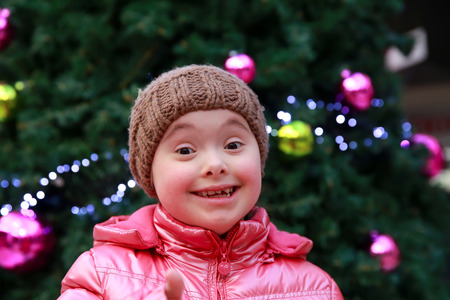 disability: Portrait of beautiful young happy girl on Christmas holiday