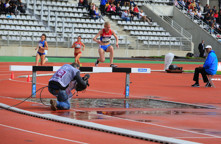athlete running: Natalya Aristarkhova from Russia COMPETE on the 3000 meters steeple on DecaNation International Outdoor Games on September 13, 2015 in Paris, France Editorial