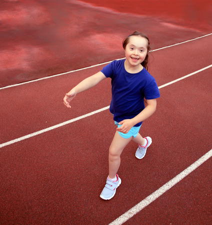 girl sport: Little girl have fun on the stadium Stock Photo