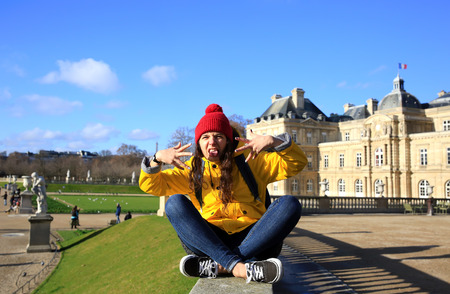 sneer: Student girl have fun in the Paris, France.