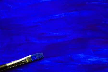 master page: Closeup of the brush on blue painting background