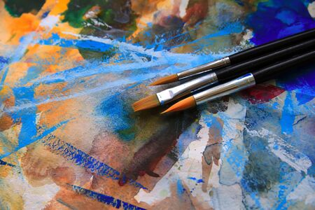 palette: Closeup of brushes and palette.