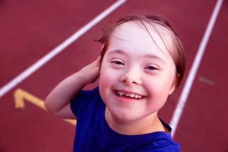 human health: Little girl have fun on the stadium Stock Photo