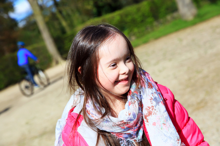 playgroup: Portrait of beautiful girl in the park Stock Photo